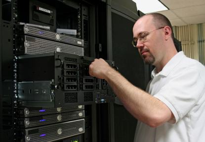Network administrator working on server hardware