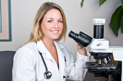 Pathologist using a microscope