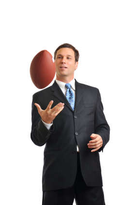 Sports management professional holding a football